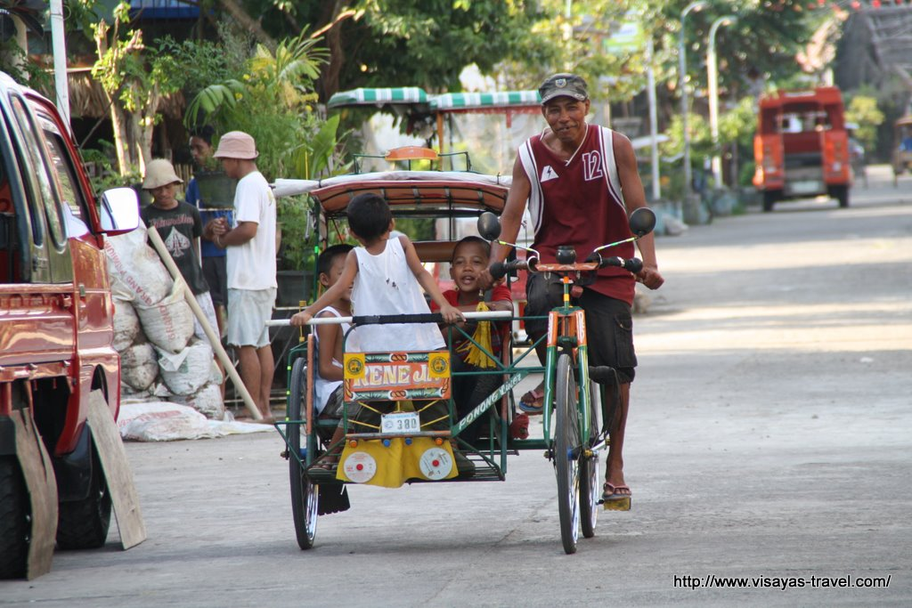 Children in a pedicab